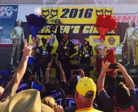 Pro Stock winner Jason Line celebrating in the winner's circle with Top Fuel victor Antron Brown and Funny Car winner Alexis DeJoria